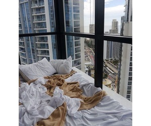bed, pillows, and windows image