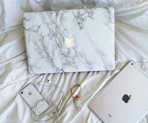 iphone, apple, and ipad image