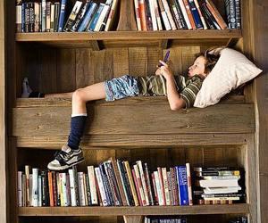 books, boy, and bookshelf image