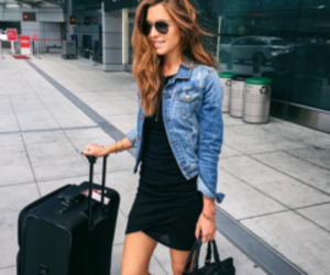 black dress, jean jacket, and suitcase image
