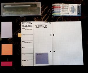 book, marker pens, and motivation image