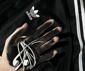'hands', 'black', and 'white' image