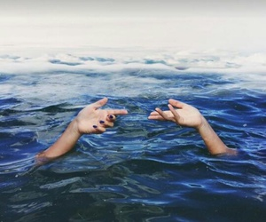 hands, ocean, and sea image