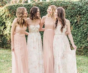bride, family, and bridesmaids image