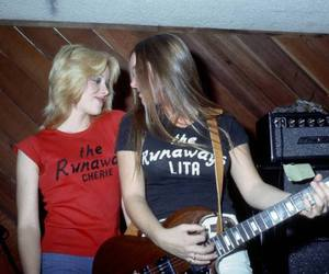 the runaways, Cherie Currie, and lita ford image