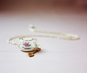 necklace, cup, and flowers image