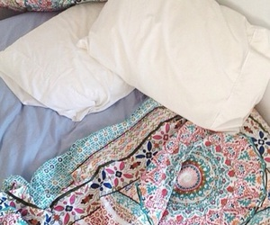 bed, pillows, and tapestries image