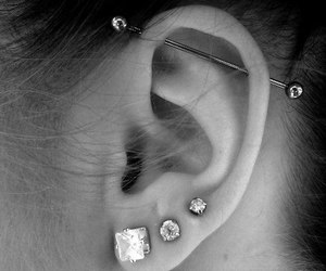 piercing, helix, and industrial image