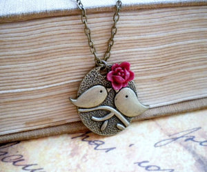 bird necklace, cameo, and charm image