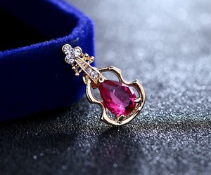 gold brooch, purple crystal, and crystal brooch image