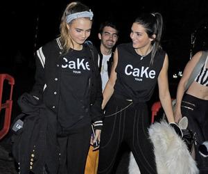 kendall jenner, cara delevingne, and cake image