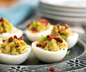 deviled eggs, avocado, and eggs image