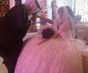 wedding, arab, and kiss image