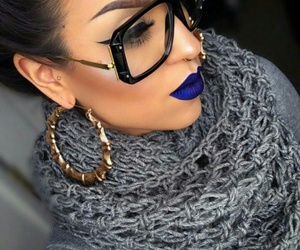 black glasses, gold hoops, and grey knit scarf image