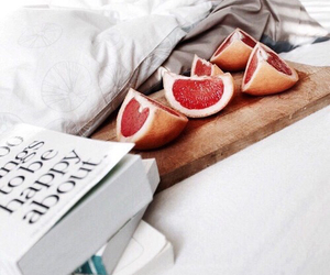 bed, grapefruit, and books image