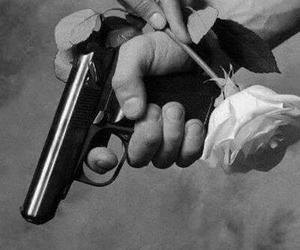 rose, gun, and black and white image