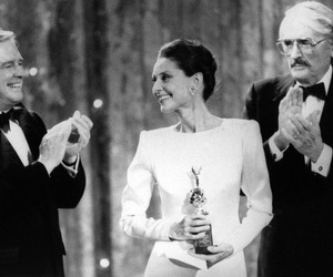 audrey hepburn, George Peppard, and gregory peck image