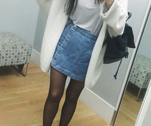 black tights, white cardigan, and straight black hair image