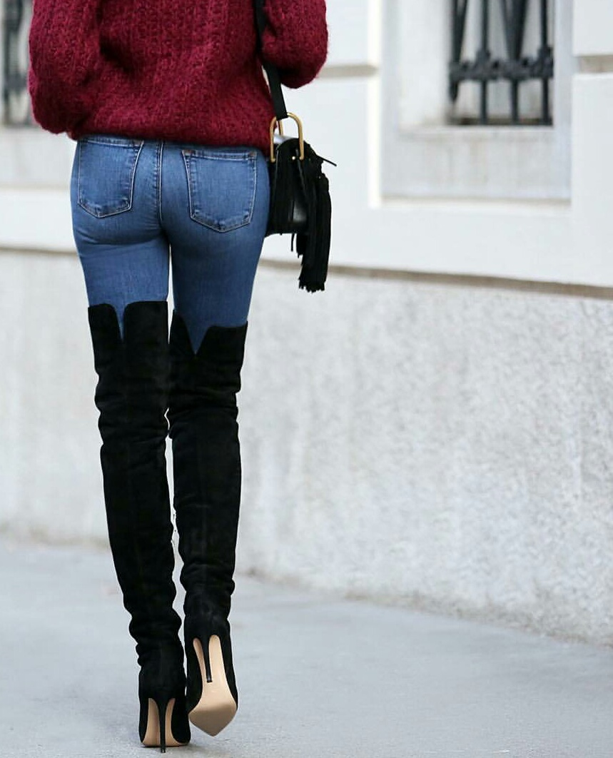 blue jeans, burgundy sweater, and black knee high boots image