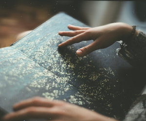 book, vintage, and hands image