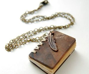 book, accessories, and feather image