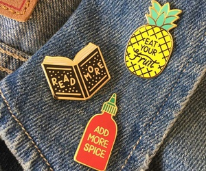pins, jeans, and book image