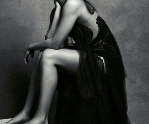 Mila Kunis and black and white image