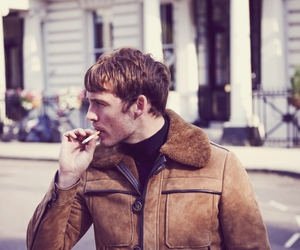 sam claflin and cigarette image