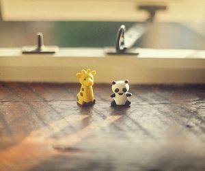 panda, giraffe, and toys image