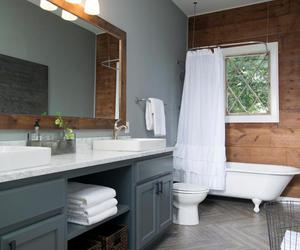 clawfoot tub, sinks, and storage image