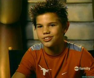 Taylor Lautner and kid image