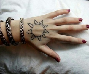 tattoo, sun, and hand image