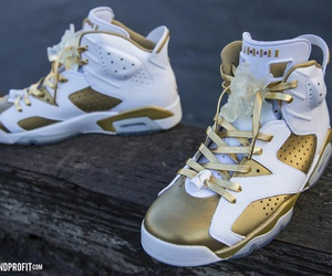 jordans and gold image