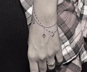 tattoo and bracelet image