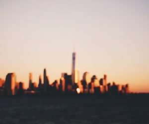 blurred, ocean, and skyline image