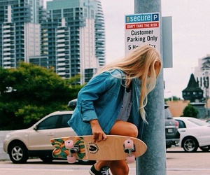 girl, city, and skateboard image