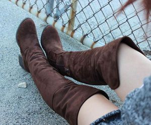 brown boots and suede boots image
