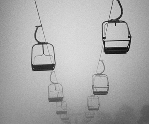 black and white, sky, and cable car image