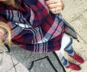 plaid scarf, gold rings, and light blue jeans image