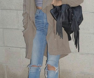 white sneakers, light blue ripped jeans, and beige jacket image