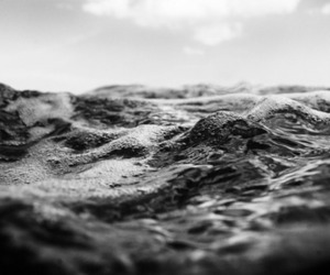 black and white, ocean, and water image