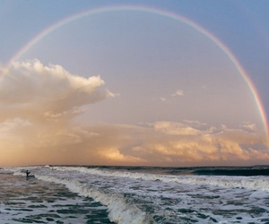 rainbow, sky, and sea image