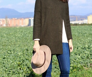 brown boots, hat, and green sweater image
