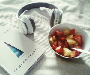 book, food, and headphones image