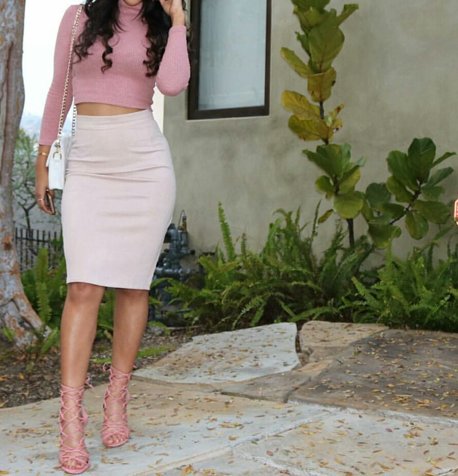white purse, light pink skirts, and pink pencil skirts image