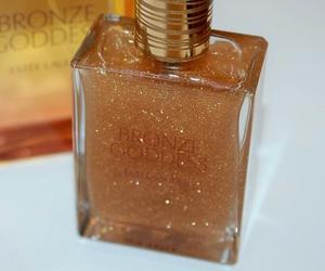 estee lauder, perfume, and bronze goddess image