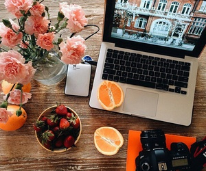 flowers, camera, and laptop image
