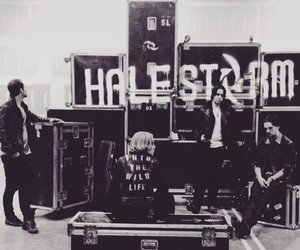 black and white, halestorm, and into the wild live image