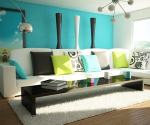 white l-shaped sofa, colorful throw pillows, and black glossy coffee table image