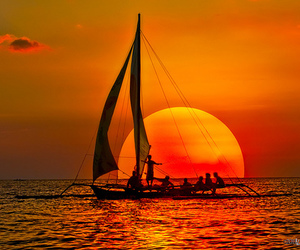 sunset, sun, and boat image